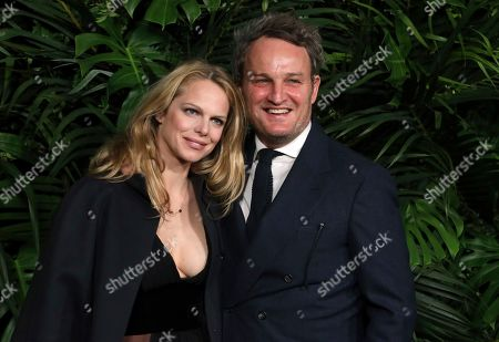 Stock Photo of Cecile Breccia, Jason Clarke. Cecile Breccia, left, and Jason Clarke arrive at the 2020 Chanel Pre-Oscar Dinner at The Beverly Hills Hotel, in Beverly Hills, Calif