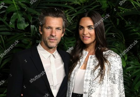 Aaron Young, Laure Heriard Dubreuil. Aaron Young, left, and Laure Heriard Dubreuil arrive at the 2020 Chanel Pre-Oscar Dinner at The Beverly Hills Hotel, in Beverly Hills, Calif