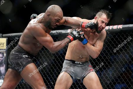 Jon Jones, left, connects with a punch to the face of Dominick Reyes, right, during a light heavyweight mixed martial arts bout at UFC 247, in Houston