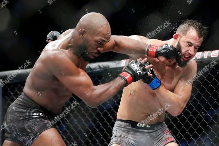 Jon Jones, left, connects a punch on Dominick Reyes, right, during a light heavyweight mixed martial arts bout at UFC 247, in Houston