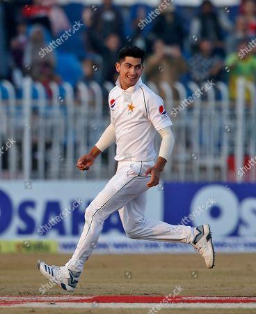 Pakistan pacer Naseem Shah celebrates after taking the wicket of Bangladesh batsman Mahmudullah during the third day of their 1st test cricket match at Rawalpindi cricket stadium in Rawalpindi, Pakistan