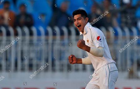 Pakistan pacer Naseem Shah celebrates after taking the wicket of Bangladesh batsman Mahmudullah to complete his hat-trick during the third day of their 1st test cricket match at Rawalpindi Cricket Stadium, in Rawalpindi, Pakistan