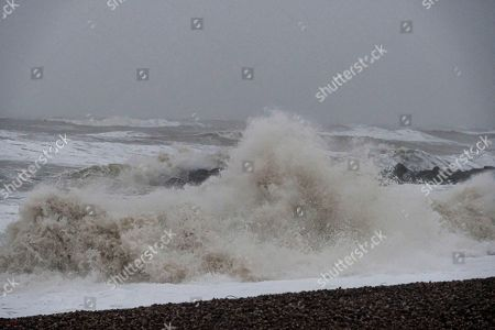 Storm Ciara hits the Dorset coast at West Bay where winds of up to 75 mph, heavy rain and high tides have led to both flood warnings and amber wind warnings being issued.