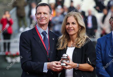 Stock Photo of Arantxa Sanchez Vicario with Stuart Miller receiving the Commitment Award