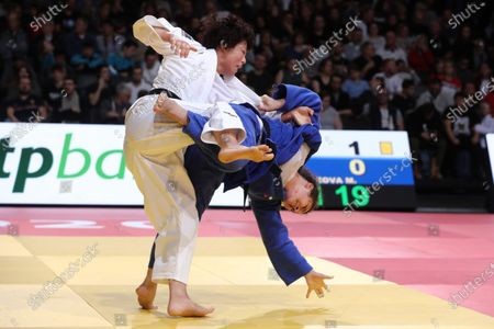 Yoko Ono of Japan (white) in action with Madina Taimazova of Russia (blue) during the -70kg Women's Round 3 at the Paris Grand Slam judo tournament, in Paris, France, 09 February 2020.