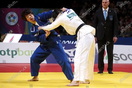 Saki Niizoe of Japan (white) in action with Yoko Ono of Japan (blue) during the women's -70kg final match at the Paris Grand Slam judo tournament, in Paris, France, 09 February 2020.