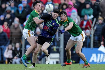 Stock Photo of Meath vs Mayo. Mayo's Conor Loftus is tackled by James McEntee and Ethan Devine of Meath