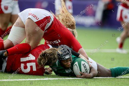 Ireland Women vs Wales Women. Ireland's Linda Djougang scores a try