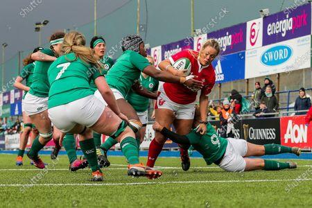 Ireland Women vs Wales Women. Wales' Cara Hope drives for the line against Kathryn Dane and Linda Djougang of Ireland