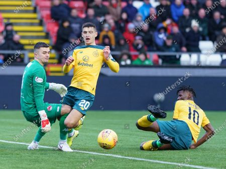 Marian Shved of Celtic goes down inside the penalty area in challenge with Clyde goalkeeper David Mitchell