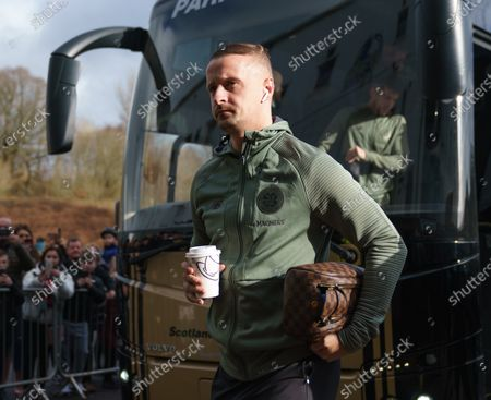 Leigh Griffiths of Celtic steps off the team bus with a hot drink in his hand