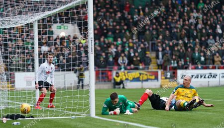 Celtic captain Scott Brown scores to give them a 2-0 lead after beating Barry Cuddihy of Clyde to the ball and tapping it past Clyde goalkeeper David Mitchell
