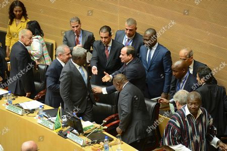 Egypt's President Abdel Fattah al-Sisi, center, the outgoing Chairman of the African Union (AU), is greeted at opening session of the 33rd AU Summit where he was to hand over the chairmanship to South Africa's President Cyril Ramaphosa, at the AU headquarters in Addis Ababa, Ethiopia. Topics on the table for discussion included the situations in Libya and Sudan, as well as President Donald Trump's Middle East initiative