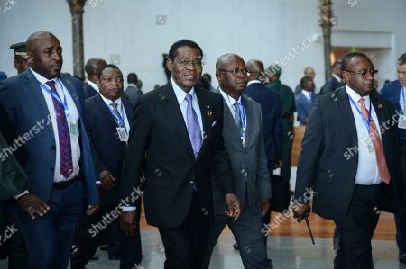 Stock Picture of Equatorial Guinea President Teodoro Obiang, center, arrives for the opening session of the 33rd African Union (AU) Summit, at the AU headquarters in Addis Ababa, Ethiopia. Topics on the table for discussion included the situations in Libya and Sudan, as well as President Donald Trump's Middle East initiative