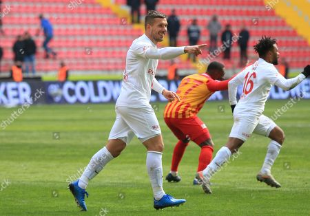 Antalyaspor's Lukas Podolski, centre, celebrates affter scoring a goal which was later disallowed, during a Turkish Super League soccer match between Antalyaspor and Kayserispor in Kayseri, Turkey,. Podolski played his first match for Antalyaspor