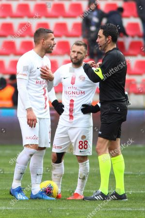Antalyaspor's Lukas Podolski, left, argues with the referee after he scored a goal that was later disallowed, during a Turkish Super League soccer match between Antalyaspor and Kayserispor in Kayseri, Turkey,. Podolski played his first match for Antalyaspor