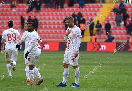 Antalyaspor's Lukas Podolski, centre, stands after scoring a goal which was later disallowed, during a Turkish Super League soccer match between Antalyaspor and Kayserispor in Kayseri, Turkey,. Podolski played his first match for Antalyaspor