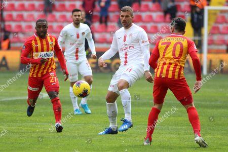 Antalyaspor's Lukas Podolski, centre, controls the ball during a Turkish Super League soccer match between Antalyaspor and Kayserispor in Kayseri, Turkey,. Podolski played his first match for Antalyaspor