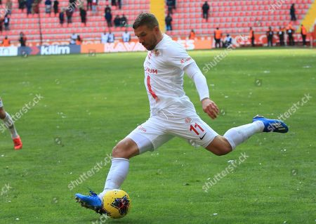 Antalyaspor's Lukas Podolski shoots the ball during a Turkish Super League soccer match between Antalyaspor and Kayserispor in Kayseri, Turkey,. Podolski played his first match for Antalyaspor