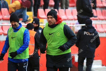 Antalyaspor's Lukas Podolski, centre, warms up prior to a Turkish Super League soccer match between Antalyaspor and Kayserispor in Kayseri, Turkey,. Podolski played his first match for Antalyaspor