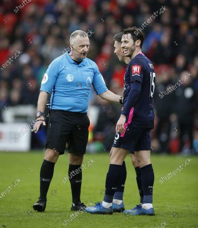 Referee Jon Moss talks to Harry Wilsona and Adam Smith of Bournemouth