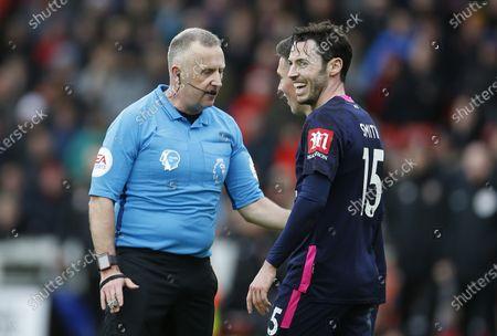 Referee Jon Moss talks to Referee Jon Moss talks to Harry Wilsona and Adam Smith of Bournemouth of Bournemouth