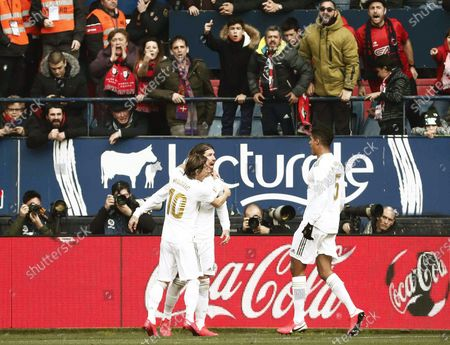 Real Madrid's Sergio Ramos (C) celebrates with teammates Luka Modric (L) and Raphael Varane (R) after scoring the 2-1 lead during the Spanish La Liga soccer match between CA Osasuna and Real Madrid at El Sadar stadium in Pamplona, northern Spain, 09 February 2020.