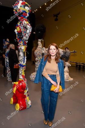 Stock Photo of Julianne Moore attends the Tory Burch fashion show at Sotheby's during NYFW Fall/Winter 2020, in New York