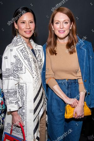 Lucy Liu and Julianne Moore attend the Tory Burch fashion show at Sotheby's during NYFW Fall/Winter 2020, in New York