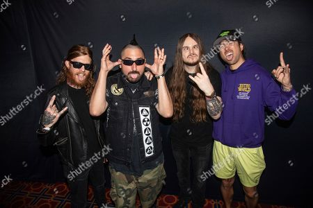"Stock Picture of Alan Ashby, from left, David Valentino ""Tino"" Arteaga, Aaron Pauley and Phil Manansala of Of Mice & Men are seen on board the Carnival Valor during day five of the ShipRocked cruise on"