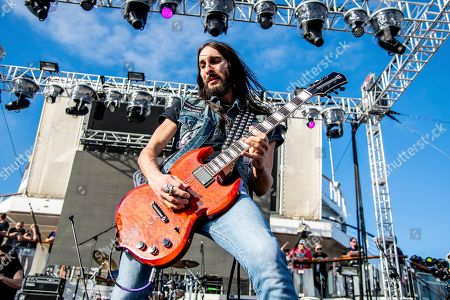 Stock Photo of Dario Lorina of The Stowaways is seen on board the Carnival Valor during day three of the ShipRocked cruise on