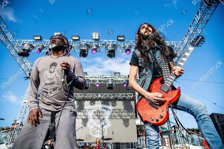 Stock Image of Corey Glover Dario Lorina. Corey Glover, left, and Dario Lorina of The Stowaways is seen on board the Carnival Valor during day three of the ShipRocked cruise on
