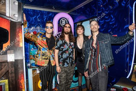 Stock Photo of Arejay Hale, Joe Hottinger, Lzzy Hale, Josh Smith. Arejay Hale, from left, Joe Hottinger, Lzzy Hale and Josh Smith of Halestorm are seen on board the Carnival Valor during day two of the ShipRocked cruise on