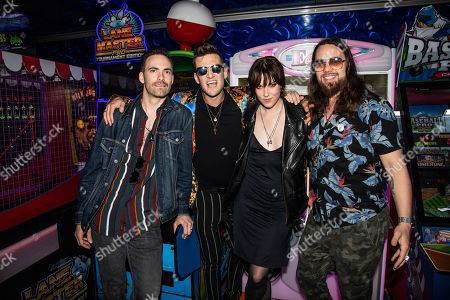 Stock Image of Josh Smith, Arejay Hale, Lzzy Hale, Joe Hottinger. Josh Smith, from left, Arejay Hale, Lzzy Hale and Joe Hottinger of Halestorm are seen on board the Carnival Valor during day two of the ShipRocked cruise on