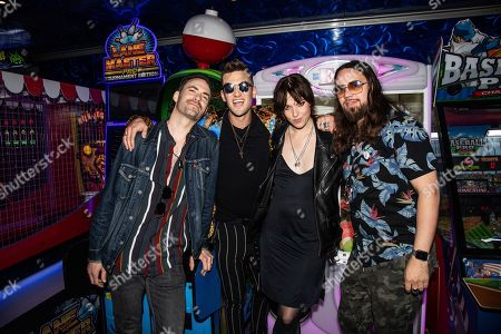Stock Picture of Josh Smith, Arejay Hale, Lzzy Hale, Joe Hottinger. Josh Smith, from left, Arejay Hale, Lzzy Hale and Joe Hottinger of Halestorm are seen on board the Carnival Valor during day two of the ShipRocked cruise on