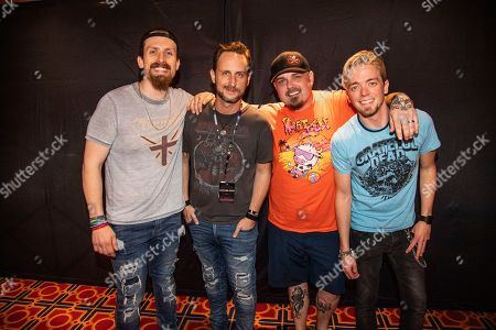John Fred Young, Jon Lawhon, Chris Robertson, Ben Wells. John Fred Young, from left, Jon Lawhon, Chris Robertson and Ben Wells of Black Stone Cherry are seen on board the Carnival Valor during day two of the ShipRocked cruise on