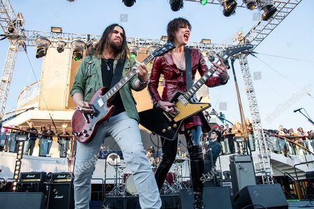 Joe Hottinger, Lzzy Hale. Joe Hottinger, left, and Lzzy Hale of Halestorm are seen on board the Carnival Valor during day one of the ShipRocked cruise on