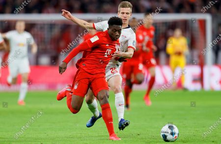 Bayern Munich's Alphonso Davies (L) in action against Leipzig's Daniel Carvajal (R) during the German Bundesliga soccer match between FC Bayern Munich and RB Leipzig in Munich, Germany, 09 February 2020.