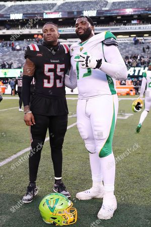 Stock Picture of New York Guardians defensive end Charles Wright (55) and Tampa Bay Vipers offensive tackle Martez Ivey (73) pose for a photo after an XFL football game, in East Rutherford, N.J. The New York Guardians won 23-3