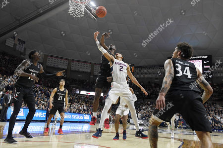 Stock Picture of Connecticut's James Bouknight (2) is fouled by Cincinnati's Keith Williams in the second of an NCAA college basketball game, in Storrs, Conn