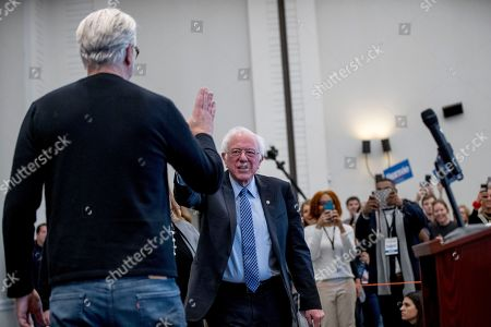 Tim Robbins, Bernie Sanders. Actor Tim Robbins, left, introduces Democratic presidential candidate Sen. Bernie Sanders, I-Vt., to speak at a campaign stop at the Hanover Inn Dartmouth, in Hanover, N.H