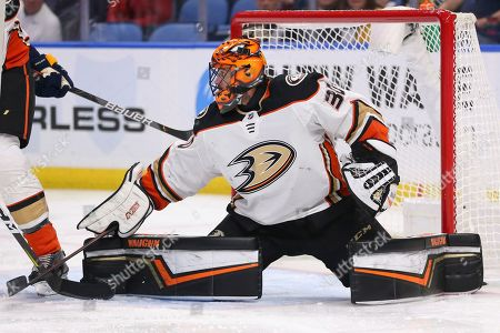 Anaheim Ducks goalie Ryan Miller (30) makes a pad-save during the first period of an NHL hockey game against the Buffalo Sabres, in Buffalo, N.Y