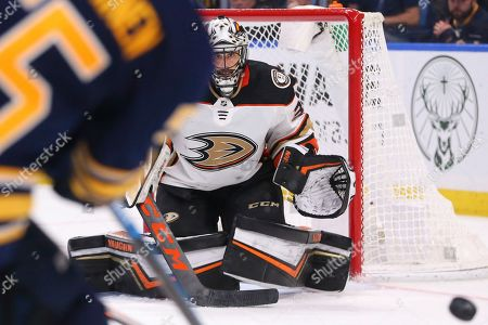 Anaheim Ducks goalie Ryan Miller (30) keeps his eyes on the puck during the third period of an NHL hockey game against the Buffalo Sabres, in Buffalo, N.Y
