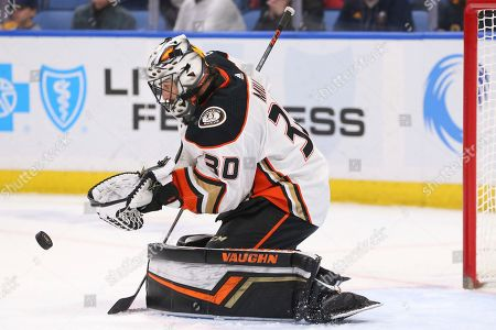 Anaheim Ducks goalie Ryan Miller (30) makes a save during the third period of an NHL hockey game against the Buffalo Sabres, in Buffalo, N.Y