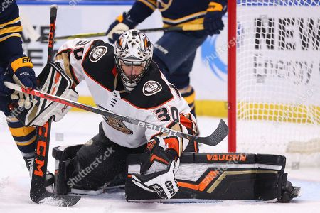 Anaheim Ducks goalie Ryan Miller (30) makes a glove save during the third period of an NHL hockey game against the Buffalo Sabres, in Buffalo, N.Y