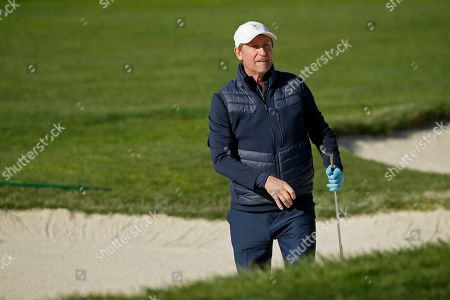 Stock Image of Wayne Gretzky follows his shot out of a bunker onto the second green of the Pebble Beach Golf Links during the final round of the AT&T Pebble Beach National Pro-Am golf tournament, in Pebble Beach, Calif