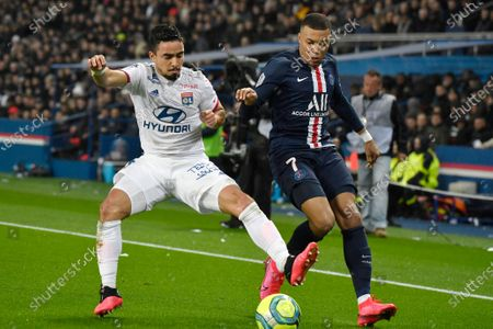 Stock Picture of Paris Saint Germain's Kylian Mbappe (R) and Lyon's Rafael Da Silva (L) in action during the French Ligue 1 soccer match between PSG and Lyon at the Parc des Princes stadium in Paris, France, 09 February 2020.