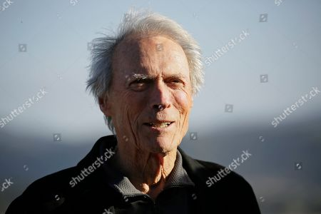Clint Eastwood stands on the 18th green of the Pebble Beach Golf Links during the awards ceremony of the AT&T Pebble Beach National Pro-Am golf tournament, in Pebble Beach, Calif