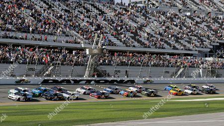 Ryan Newman (6) and Brad Keselowski, front left, lead the field to start the NASCAR Busch Clash auto race at Daytona International Speedway, in Daytona Beach, Fla