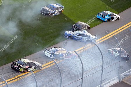 William Byron (24), Martin Truex Jr. (19), Kurt Busch (1), Austin Dillon (3), Ryan Newman (6) and Kevin Harvick (4) are involved in a multi-car accident along the front stretch after a restart from an earlier accident during the NASCAR Daytona Clash auto race at Daytona International Speedway, in Daytona Beach, Fla
